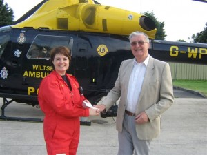 Lion Stuart Beese making donation to Wilts Air Ambulance